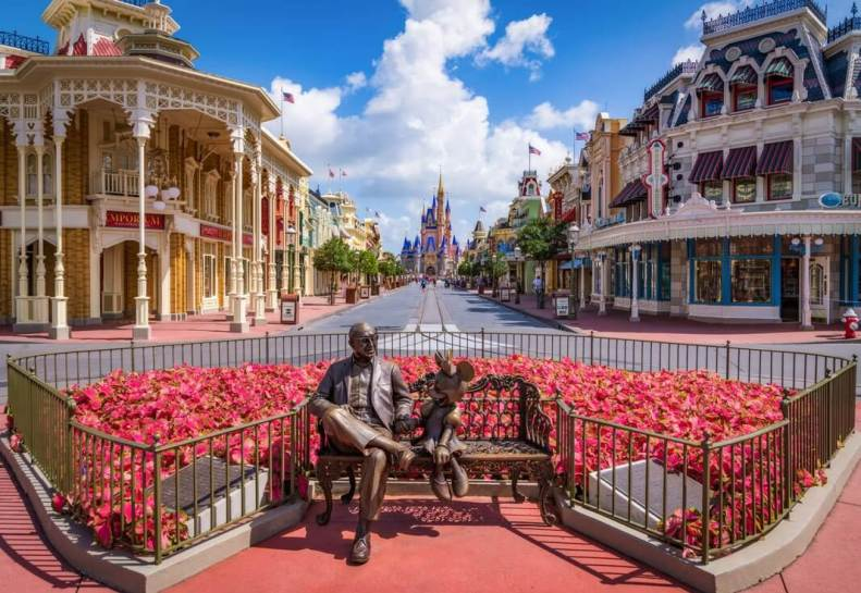 Sharing the Magic bench statue of Roy O. Disney and Minnie Mouse at Magic Kingdom
