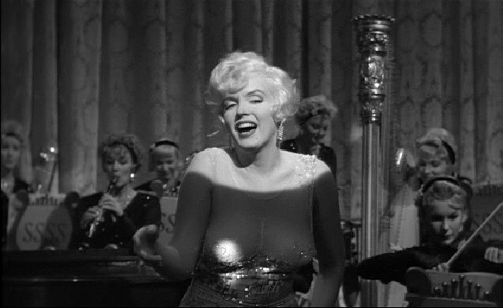 I'm not sure which is more amazing, Marilyn or that negligee/dress?