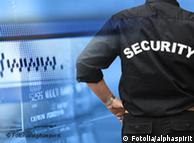 Man in security uniform stands before computer screen