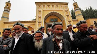 Muslim men of the Uighur ethnic group leaving the Id Kah Mosque after Friday prayers in Kashgar, Xinjiang Uighur Autonomous Region, China (Photo: EPA/HOW HWEE YOUNG)