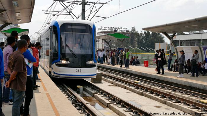 People in wait to board a tram line in Ethiopia's capital Addis Ababa.