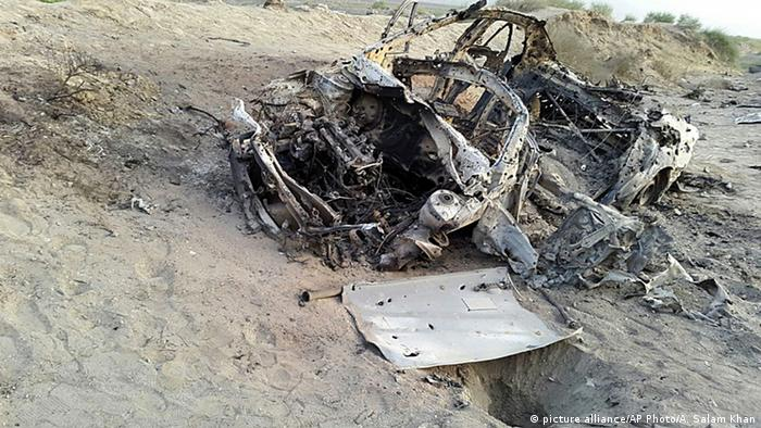 This photo taken by a freelance photographer Abdul Salam Khan using his smart phone on Sunday, May 22, 2016, purports to show the destroyed vehicle in which Mullah Mohammad Akhtar Mansour was traveling in the Ahmad Wal area in Baluchistan province of Pakistan, near Afghanistan's border (AP Photo/Abdul Salam Khan)