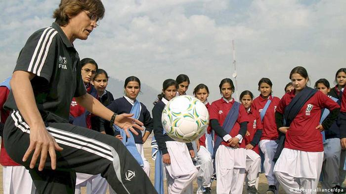 German soccer coach Monika Staab (L) gives instructions to Pakistani female soccer players during a training session