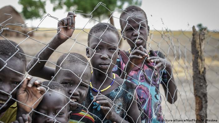 Children in South Sudan await a humanitarian aid distribution in 2015.
