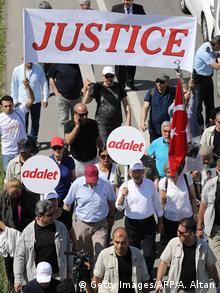 Marchers holding signs and banners for justice (Getty Images/AFP/A. Altan)