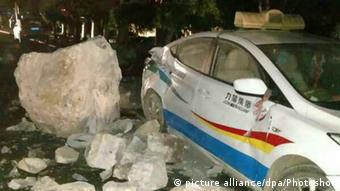 Photo taken on Aug. 8, 2017 shows a damaged car in the earthquake in Jiuzhaigou County of southwest China's Sichuan Province (picture alliance/dpa/Photoshot)