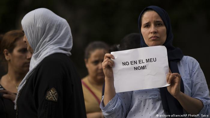 A Muslim woman holds a sign that says 'Not in my name' at a demonstration against terrorism in Ripoll, outside Barcelona