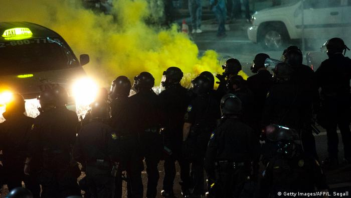 Police in riot gear using tear gas(Getty Images/AFP/L. Segall)