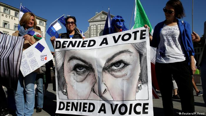 UK nationals in Florence held banners ahead of May's speech as she confirmed no deal is still better than a bad deal on Brexit