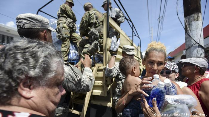 National Guard Soldiers distribute water and food