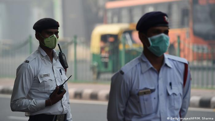 Indian policemen wear protective masks to protect themselves from heavy smog in New Delhi