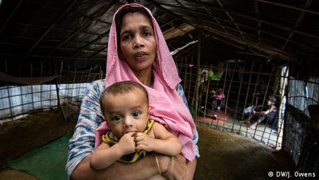 Rohingya mother holding a child