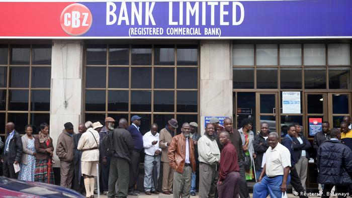 People queue outside a bank in Harare, Zimbabwe (Reuters/P. Bulawayo)