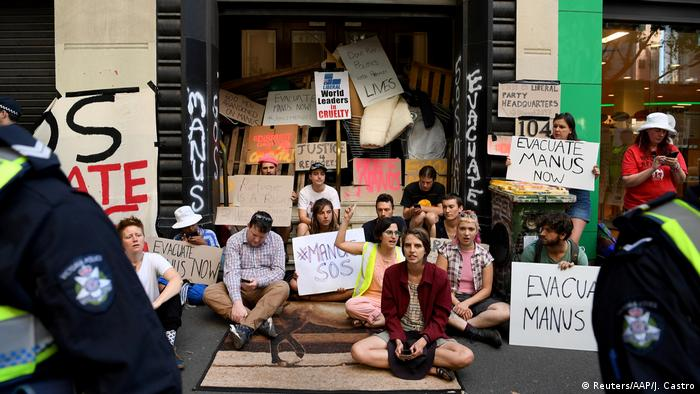 Protesters block the entrance to the Victorian Liberal party offices in Melbourne, Australia