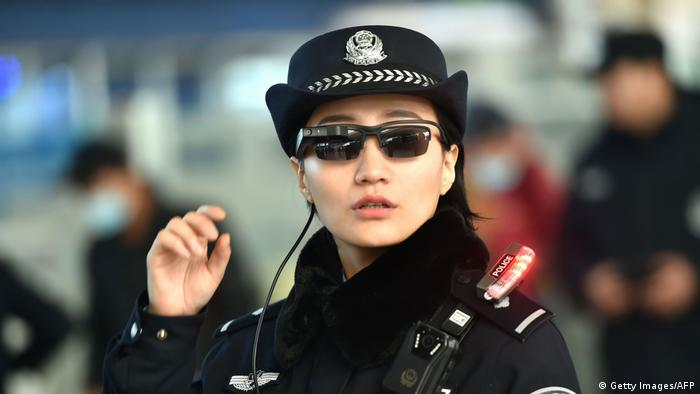 Chinese police officer strikes a pose (Getty Images/AFP)