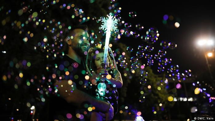 A family is seen in between soap bubbles during celebrations marking Israel's 70th Independence Day at Rabin Square in Tel Aviv, Israel