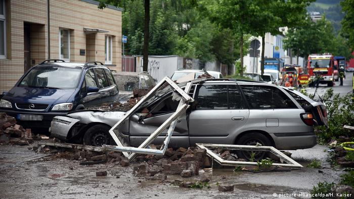 Debris from the building fell on top of vehicles parked outside