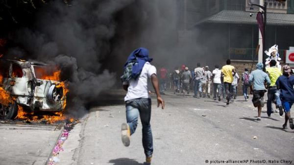 Haiti gripped by deadly riots over fuel prices | News | DW ...