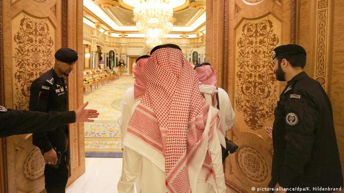 Members of the Saudi Royal House enter a hall in the Royal Palace in Riyadh