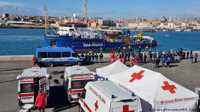 Police and Red Cross in the port of Catania
