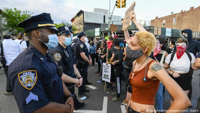 A protester faces police when Black Lives Matter protesters clash with NYPD officers
