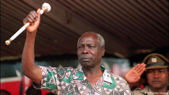 Kenya'a second president Moi salutes the crowd.