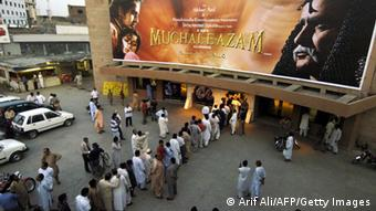 Lahore, PAKISTAN: Pakistani cinema goers queue for tickets for the Indian classic movie Mughal-e-Azam outside the Gulistan Cinema in Lahore, 23 April 2006. The forbidden love of Pakistanis for Indian movies was allowed into the open on 23 April with the public screening of a 1960 classic beloved on both sides of the border. AFP PHOTO/Arif ALI (Photo credit should read Arif Ali/AFP/Getty Images)