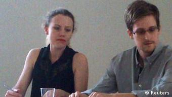 Former intelligence agency contractor Edward Snowden and Sarah Harrison (L) of WikiLeaks speak to human rights representatives in Moscow's Sheremetyevo airport July 12, 2013. Snowden is seeking temporary asylum in Russia and plans to go to Latin America eventually, an organisation endorsed by anti-secrecy group Wikileaks said on Twitter on Friday. REUTERS/Human Rights Watch/Handout (RUSSIA - Tags: POLITICS SOCIETY) NO COMMERCIAL OR BOOK SALES. NO SALES. NO ARCHIVES. FOR EDITORIAL USE ONLY. NOT FOR SALE FOR MARKETING OR ADVERTISING CAMPAIGNS