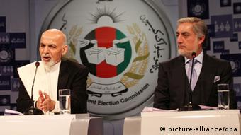 Afghan presidential candidates Ashraf Ghani (L) and Abdullah Abdullah take part in a debate at 1 TV in Kabul, Afghanistan, 08 February 2014 (Photo: EPA/S. SABAWOON)