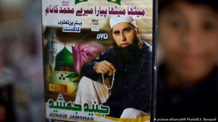 A vendor shows a DVD of Pakistan's Junaid Jamshed at a stall in Islamabad, Pakistan, Wednesday, Dec. 3, 2014<br /> (AP Photo/B.K. Bangash)