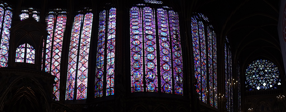 North wall of Sainte Chappelle Cathedral in Paris. Finished in 1248 c.e., the towering walls of this spectacular church are constructed almost entirely of stained glass.