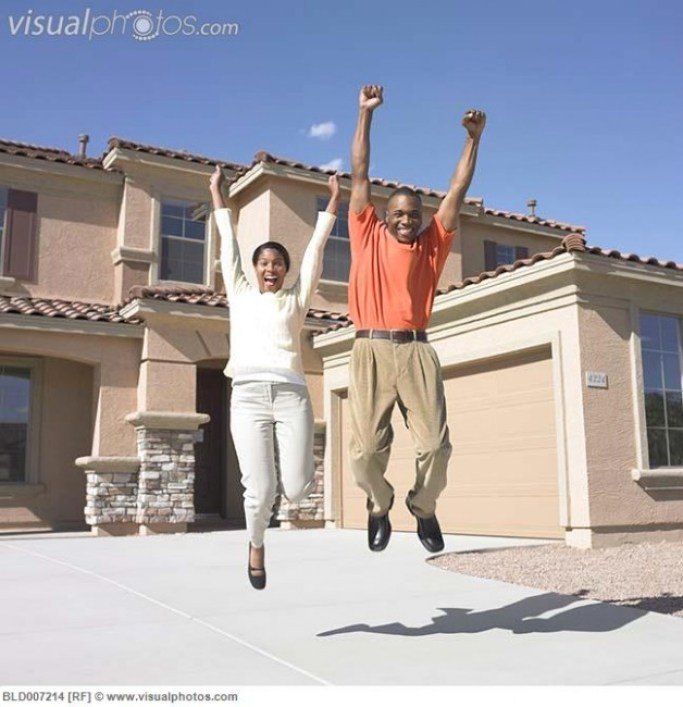 http://www.visualphotos.com/image/2x4525738/portrait_of_couple_jumping_in_front_of_house