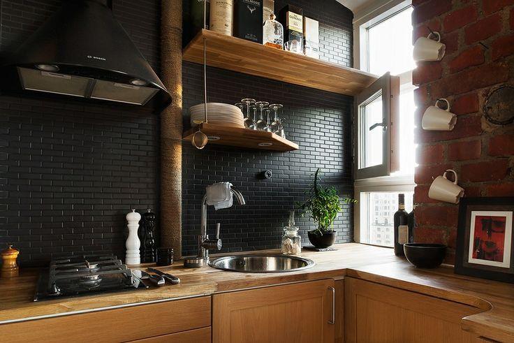 Black-subway-tile-backsplash-in-a-modern-kitchen