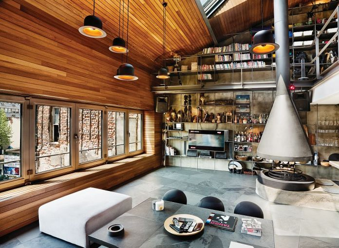 Living-room-with-industrial-style-high-ceiling-and-innovative-storage-system