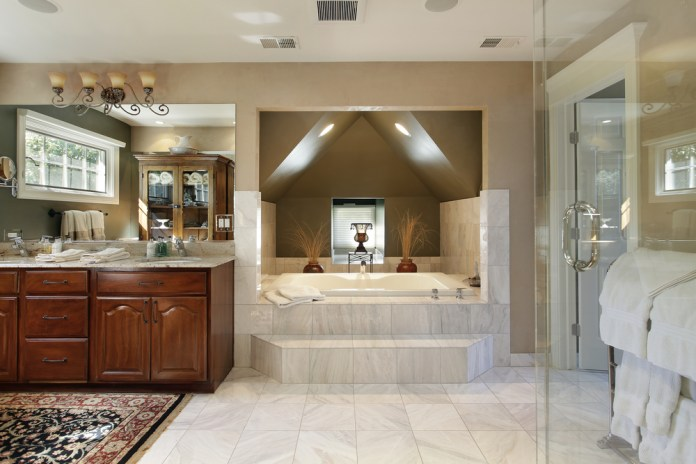 Luxury bathroom with large bathtub in a private alcove