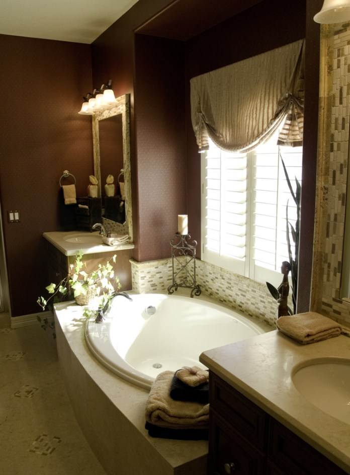 Luxury bathroom with small bathtub near window and double vantiy