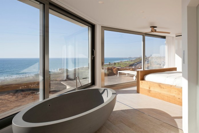 open-master-bathroom-Bedroom-Modern-with-beach-ceiling-fan-concrete