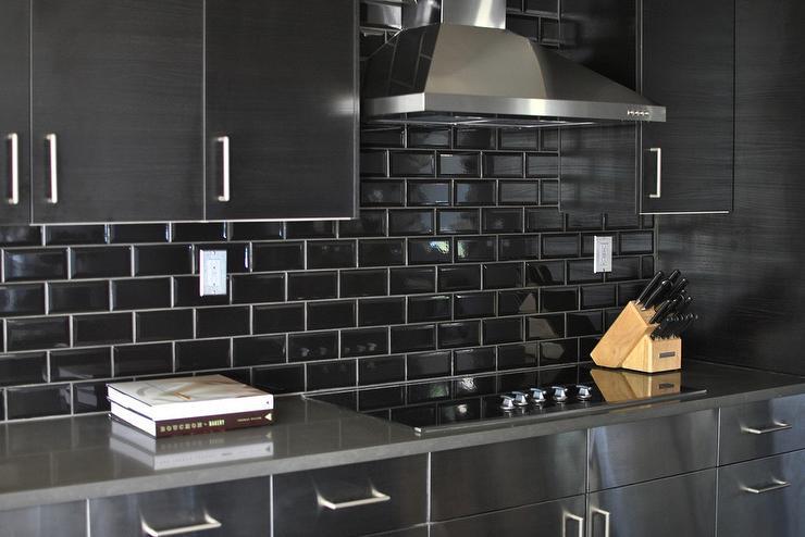 stainless-steel-kitchen-cabinets-black-subway-tile-backsplash-white-grout