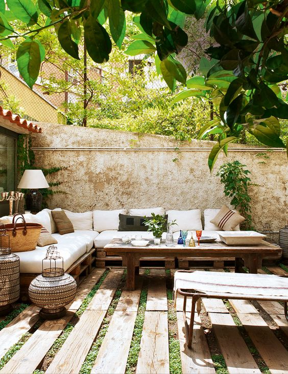 Beautiful backyard with reclaimed wood furniture and flooring