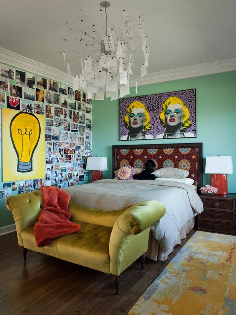 Eclectic bedroom design ideal for bachelor with beautiful night lamp and wallart.