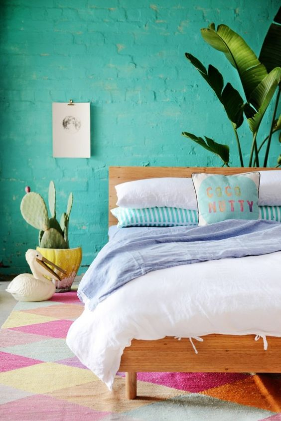Eclectic-bedroom-with classic linen to the most colourful prints and rug.