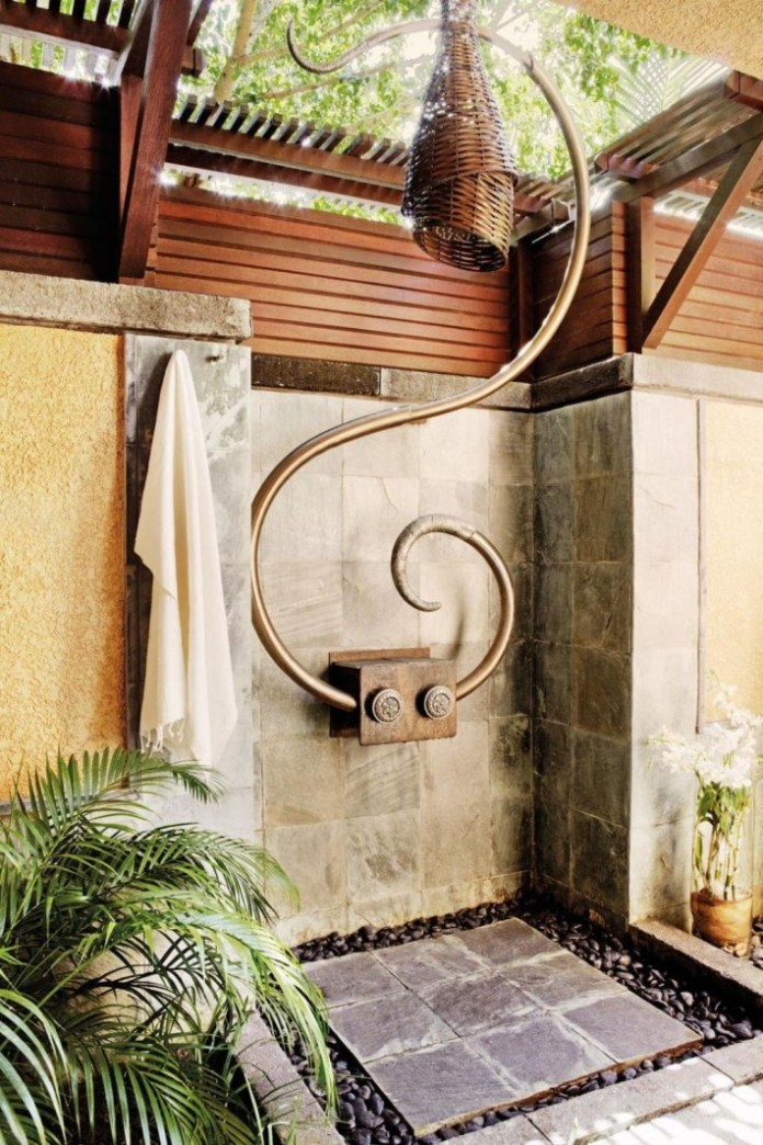 Stylish Outdoor Shower with copper shower and granite wall