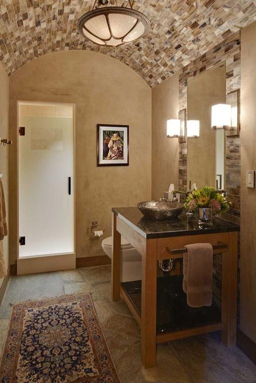 Mediterranean Bathroom with simple granite