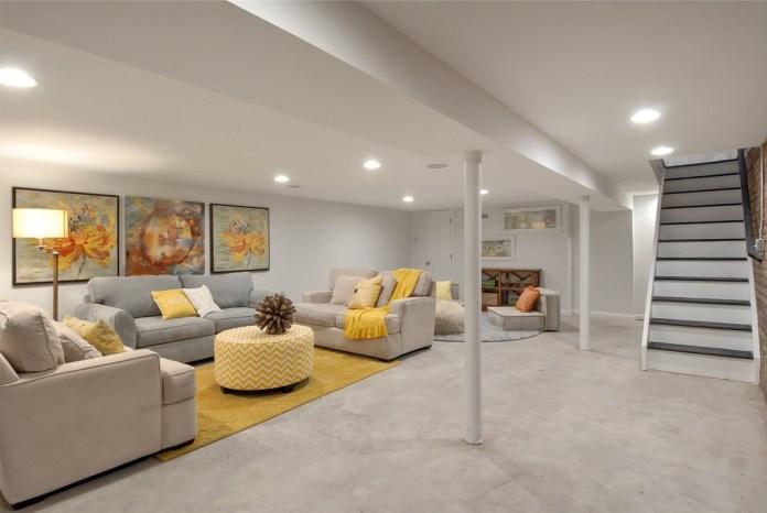 basement-with-concrete-flooring-and-basement-bar