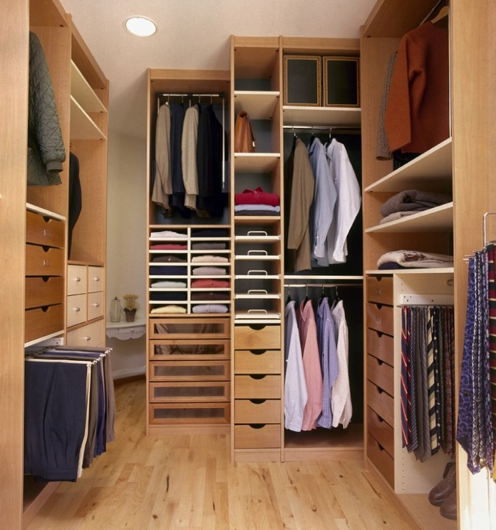 Eclectic Closet with Laminate wood shelving