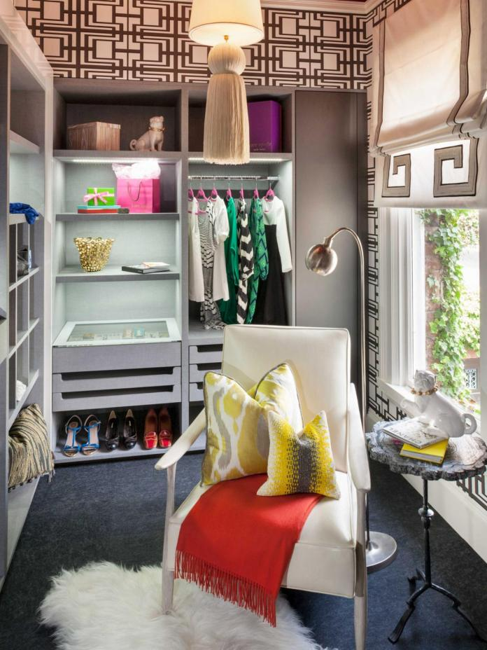 Eclectic Walk-In Closet With White Modern Armchair