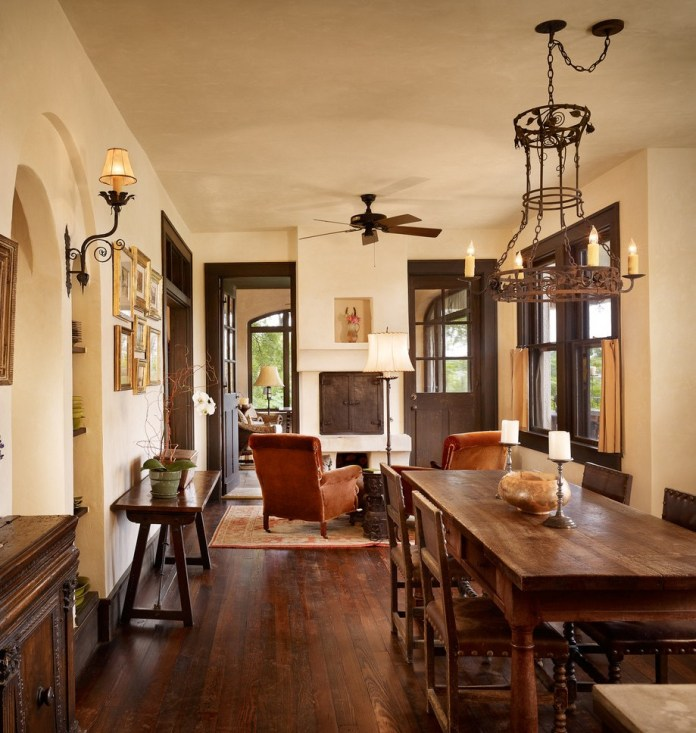 burnt-orange-chair-for-mediterranean-dining-room-with-wall-sconce