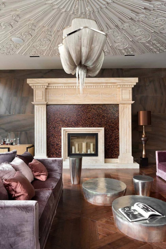 The dark velvet comfy sofa with a modern fireplace