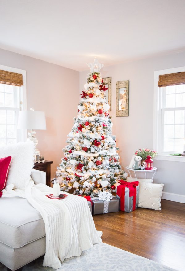 Snowy White Christmas Tree With Lots Of Red dwellingdecor