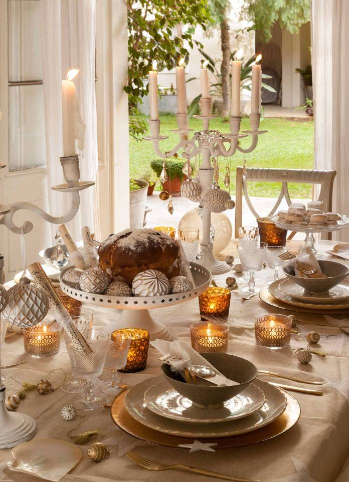 A CAKE STAND AS A BASE FOR THE CENTERPIECE